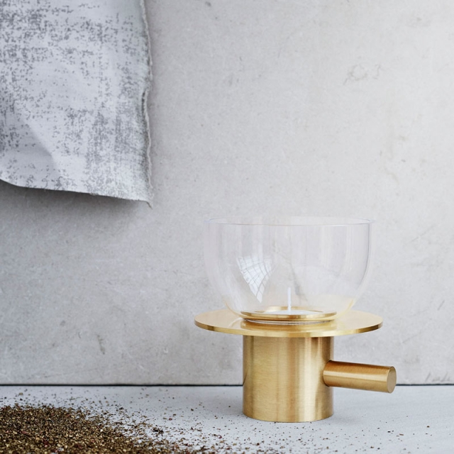 FRITZ HANSEN // Tealight, playful is the best word to describe this candleholder in beautiful massive brass. It has many faces and you can give it the look you are in the mood for.  Materials: Solid brass / glass.