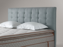 Textile headboard with removable cover. Deeply tufted, available