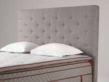 DUX Royal is a series of complementary bed accessories, such as bed skirts and decorative cushions. The design was developed in collaboration with the legendary Hotel d'Angleterre in Copenhagen. A headboard with comfortable, supportive padding. The clean